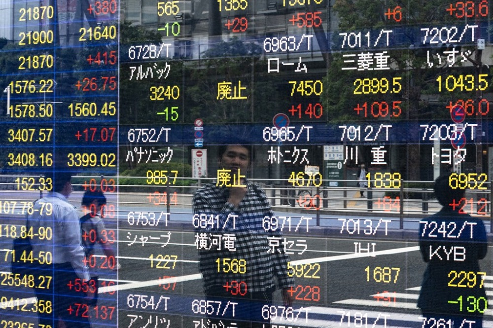 The benchmark Nikkei 225 index rose 0.27 per cent, or 63.84 points, to 23,630.88 in early trade, while the broader Topix index gained 0.53 per cent, or 8.68 points, to 1,634.42. — AFP pic