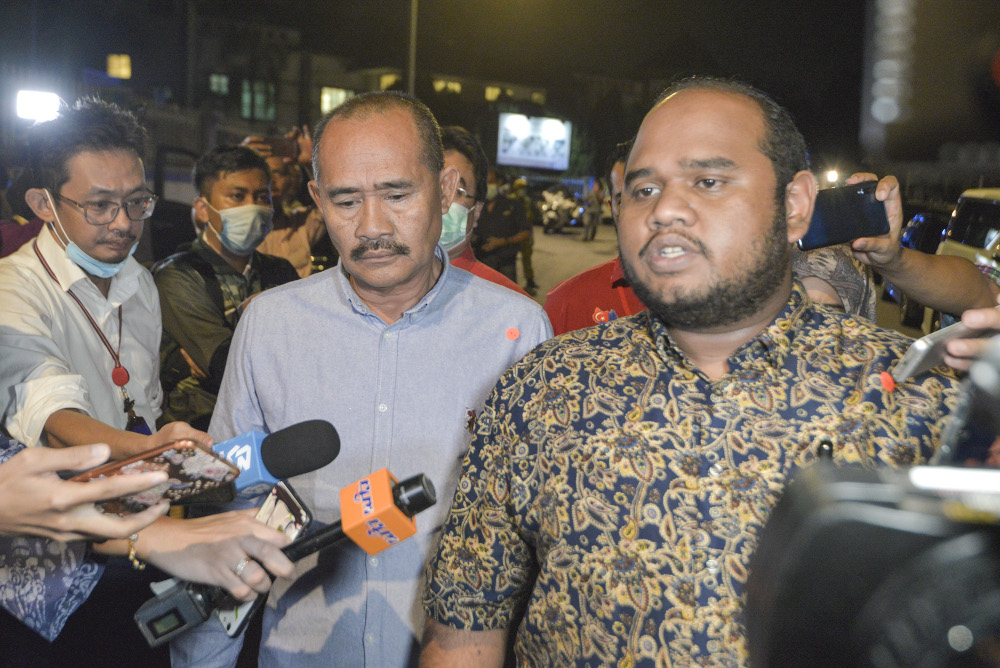 Ulya Aqamah Husamudin (right) speaks to the media after leaving the Bersatu meeting in Kuala Lumpur June 4, 2020. — Picture by Shafwan Zaidon