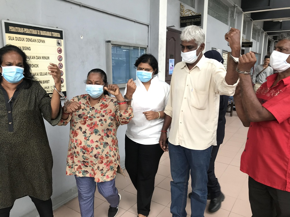 Five activists were charged at the Magistrate Court in Ipoh for defying the CMCO by gathering at HRPB, June 4, 2020. — Pictures by John Bunyan