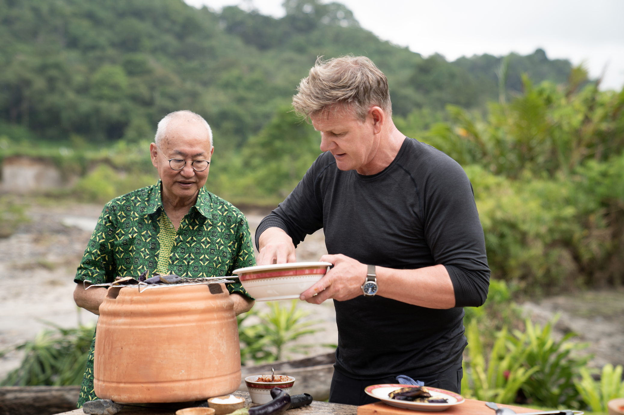 With Wongso looking over his shoulder, the pressure is on for Ramsay to get his rendang right. — Picture courtesy of National Geographic