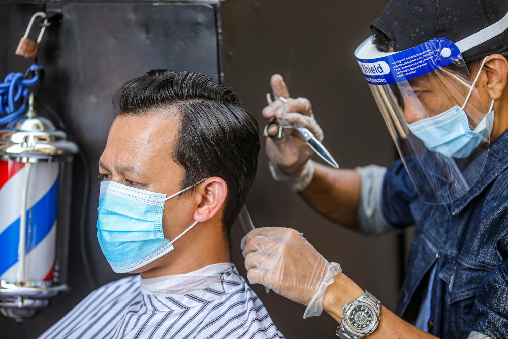 Domestic Trade and Consumer Affairs Minister Datuk Alexander Nanta Linggi said compliance with the SOP at barbershops and hairdressing salons has reached more than 90 per cent since they resumed operations on June 10. — Picture by Hari Anggara