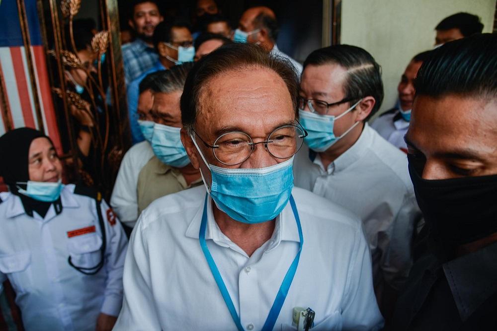 PKR president Datuk Seri Anwar Ibrahim leaves the party's headquarters in Petaling Jaya June 9, 2020. — Picture by Hari Anggara