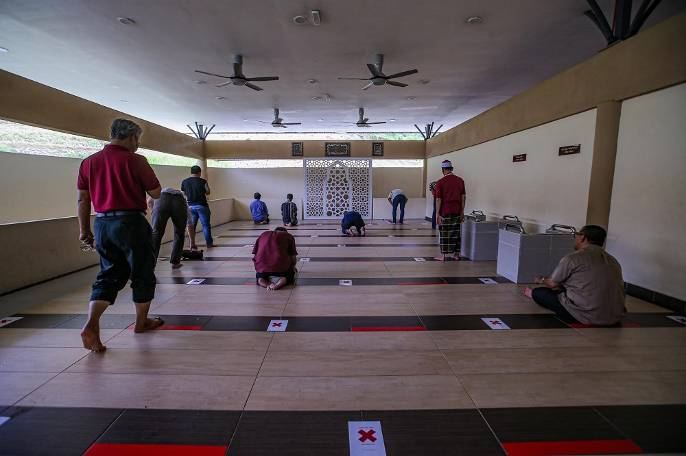 People practise social distancing at a surau located at the Rawang Rest and Relaxation stop on the first day of restricted movement control order, June 10, 2020. — Picture by Hari Anggara