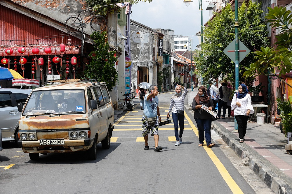 Local tourists are seen at the art district of Armenian Street in George Town June 15th. — Picture by Sayuti Zainudin