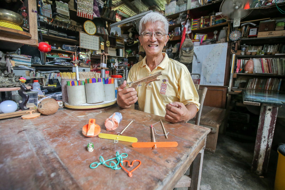 At 65-year-old, retired headmaster Wee Ong Chin does his part to promote Chinese culture and traditional games. — Picture by Farhan Najib