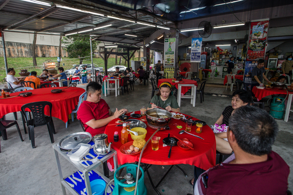 Patrons are seen dining at the Tai Tao Steamboat restaurant in Menjalara, Kepong June 20, 2020. — Picture by Firdaus Latif