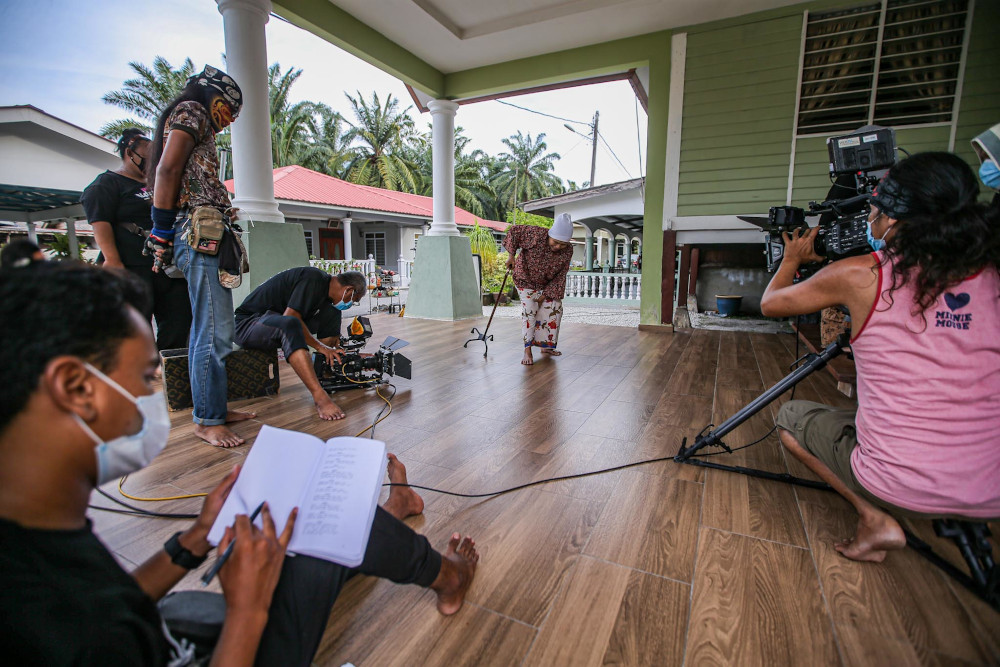 The production team from Operaklasik Sdn Bhd filming a drama during the recovery movement control order (RMCO) on June 23, 2020. — Picture by Hari Anggara
