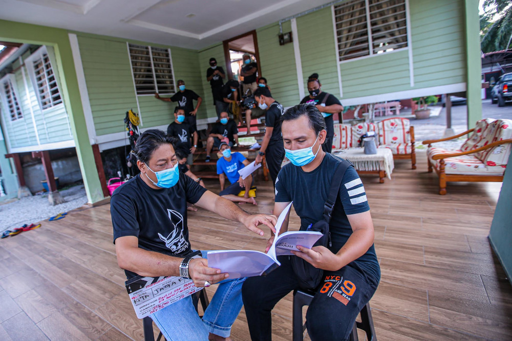 The production crew from Operaklasik Sdn Bhd during the SOP briefing before filming on June 23, 2020. — Picture by Hari Anggara