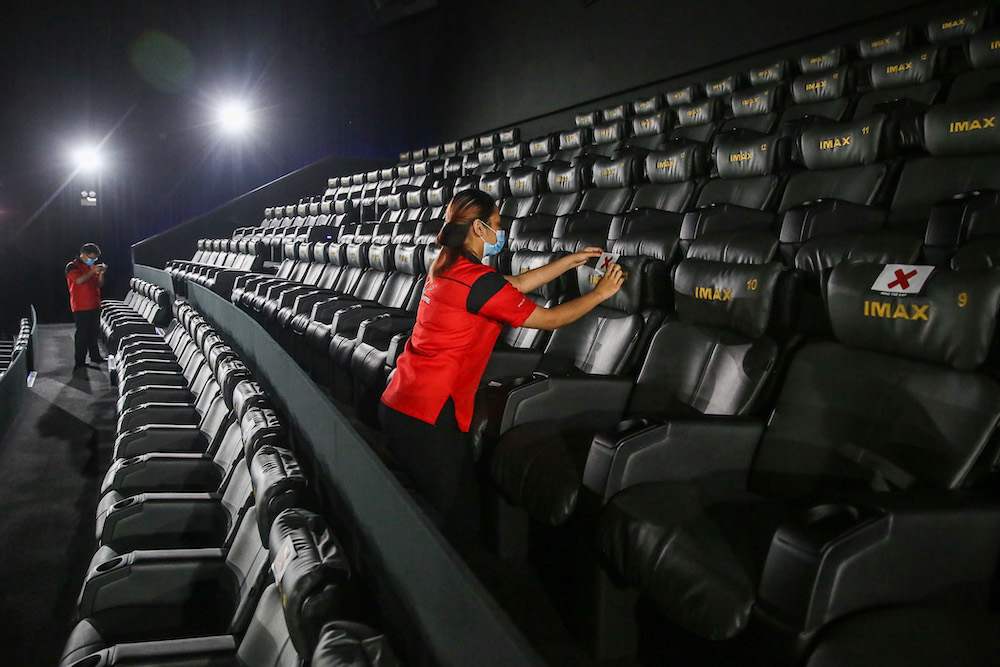 TGV Cinemas have implemented alternate seating arrangements in line with the social distancing rules. — Picture by Mohd Yusof Mat Isa