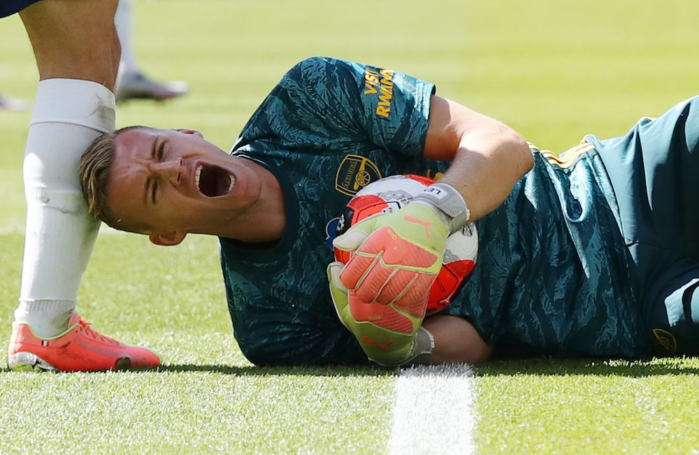 Arsenal's Bernd Leno reacts after sustaining an injury during the match against Brighton, June 20, 2020. — Gareth Fuller/Pool handout via Reuters
