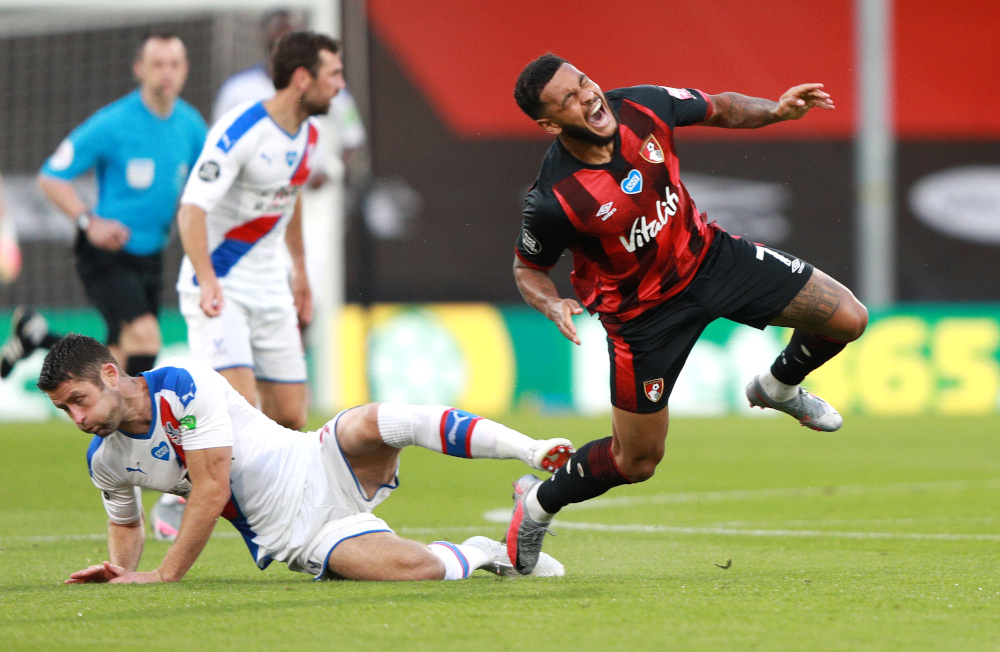 Bournemouth's Joshua King sustains an injury after a challenge by Crystal Palace's Gary Cahill as play resumes behind closed doors at Vitality Stadium, Bournemouth, Britain, June 20, 2020. — Reuters pic