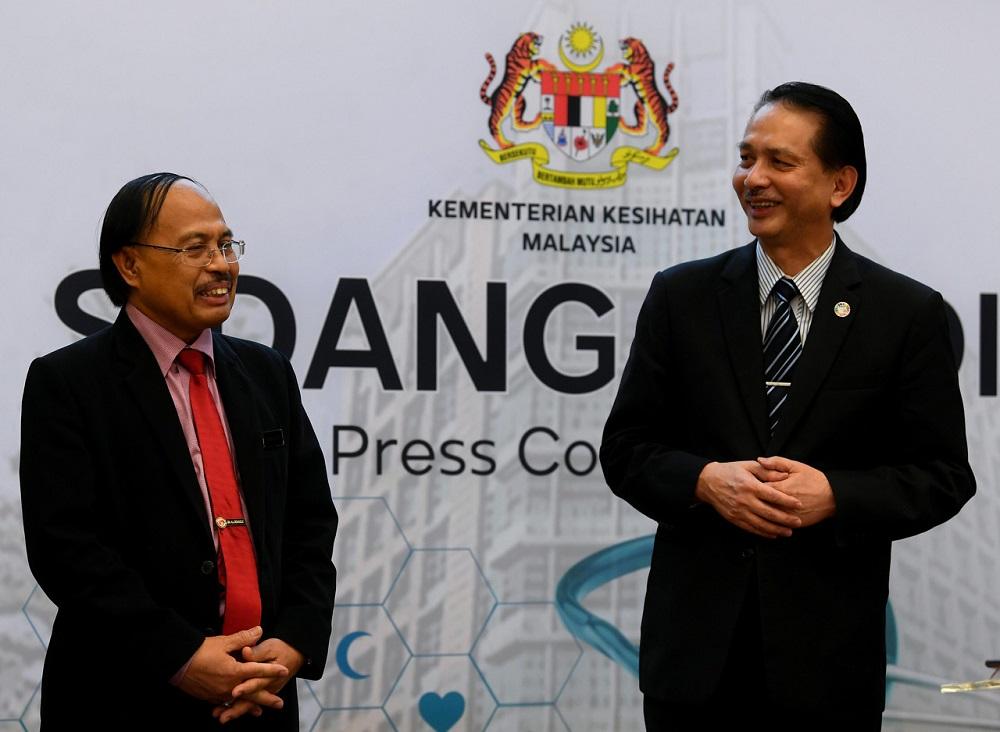 Health deputy director-general (Medical) Datuk Dr Rohaizat Yon (left) and Health director-general Datuk Dr Noor Hisham Abdullah during a press conference in Putrajaya June 10, 2020. — Bernama pic