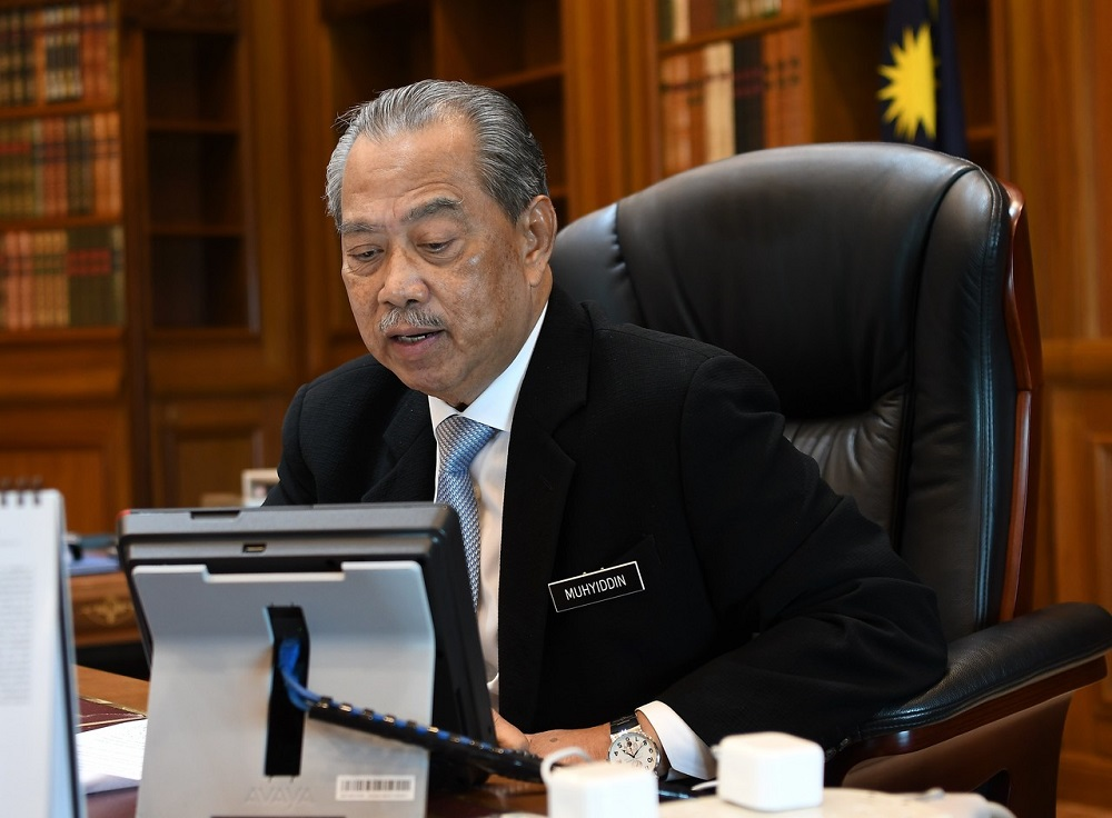 Prime Minister Tan Sri Muhyiddin Yassin in his office in Putrajaya June 23, 2020. — Bernama pic