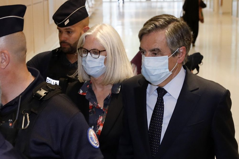 Former French Prime minister Francois Fillon (right) and his wife Penelope Fillon arrive at the Paris' courthouse on June 29, 2020 for the ruling on a trial for embezzlement in the context of an alleged job fraud. — AFP pic