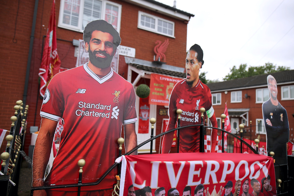 Cutout photos of Liverpool's Mohamed Salah, Virgil van Dijk and Liverpool manager Juergen Klopp are seen outside the house of Emily Farley ahead of the match between Liverpool and Everton in Liverpool, June 19, 2020. ― Reuters pic