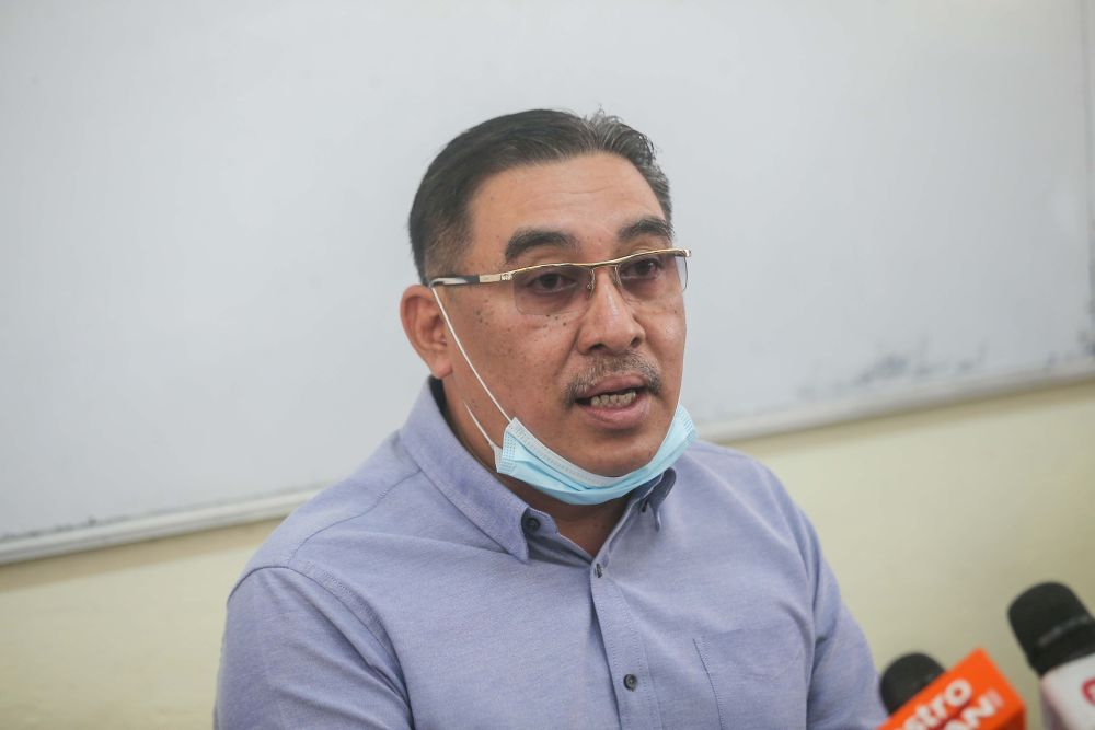 慕斯利敏表示,增迁16所华小不是教育部的新计划。-Farhan Najib摄-