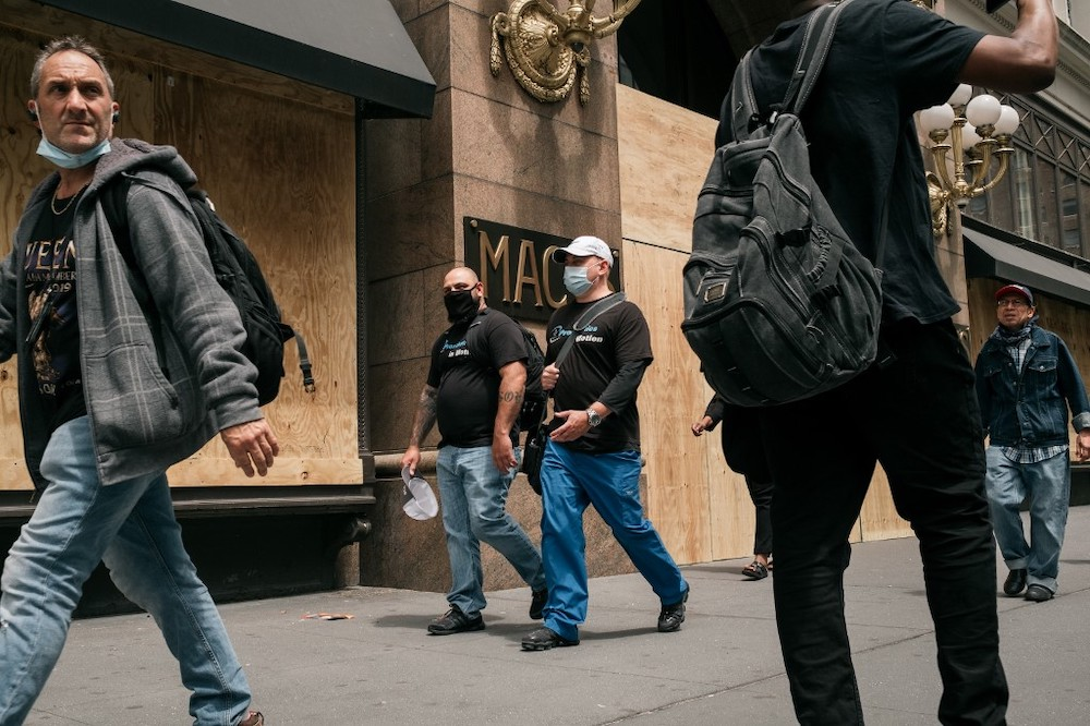 Pedestrians walk by the Macy's flagship store after workers cleaned and boarded up damage sustained during a night of violent protests and looting in Midtown, Manhattan on June 2, 2020 in New York City. ― Reuters pic