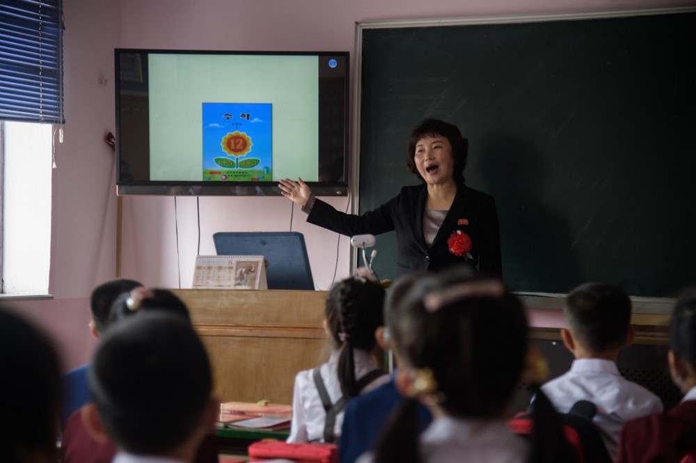 A teacher teaches a class at Hasin Primary School in Sosong District in Pyongyang following the re-opening of schools on June 3, 2020. — AFP pic