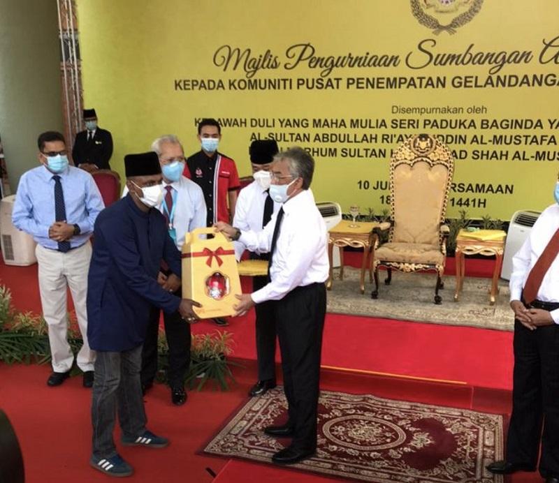 Yang di-Pertuan Agong Al-Sultan Abdullah Ri'ayatuddin Al-Mustafa Billah Shah presents a donation to the homeless community in Cheras June 10, 2020. ― Picture via Twitter/bernamadotcom