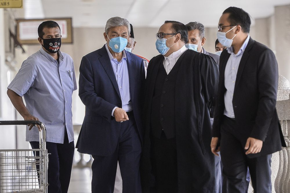Datuk Seri Ahmad Zahid Hamidi (second from left) is pictured at the Kuala Lumpur High Court June 16, 2020. — Picture by Miera Zulyana