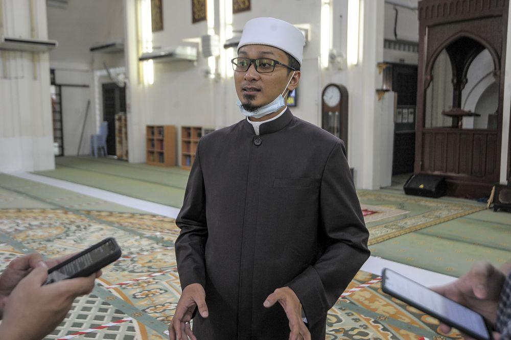 At-Taqwa Mosque imam Ahmad Saufi Mustaffa speaks to reporters after Friday prayers in Kuala Lumpur June 12, 2020.
