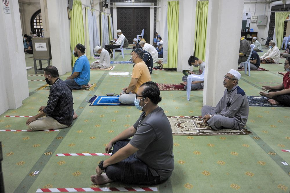 Malaysian Muslims observe social distancing while performing Friday prayers at the At-Taqwa Mosque during the recovery movement control order in Petaling Jaya June 12, 2020. — Picture by Shafwan Zaidon