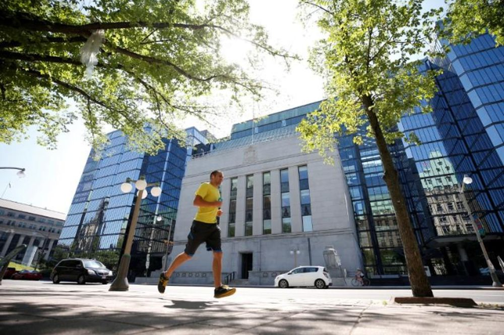 A jogger runs past the Bank of Canada building in Ottawa, Ontario, Canada, July 11, 2018. — Reuters pic