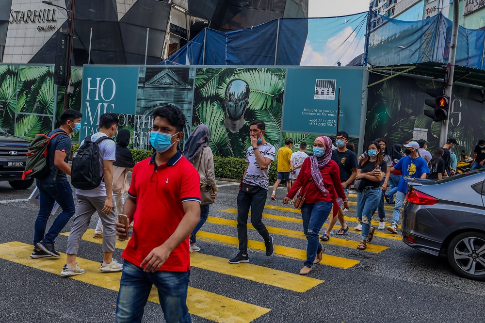 People are seen wearing protective masks as they walk along the Bukit Bintang shopping area in Kuala Lumpur May 31, 2020. ― Picture by Firdaus Latif