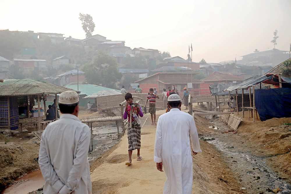 Rohingya refugees walk on a road at the Balukhali camp in Cox's Bazar, Bangladesh April 8, 2019. — Reuters pic
