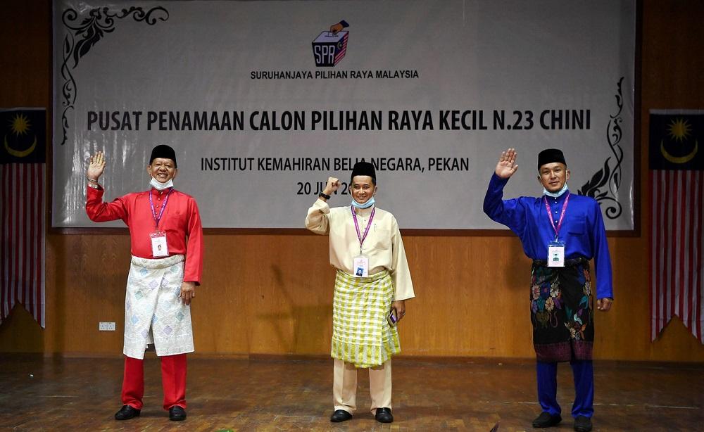 (From left) Independent candidates Tengku Datuk Zainul Hisham Tengku Hussin and Mohd Shukri Ramli, and Barisan Nasional's Mohd Sharim Md Zain at the nomination centre in Pekan June 20, 2020. ― Bernama pic