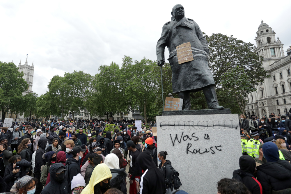 The statue of former British prime minister Winston Churchill is seen defaced in Parliament Square, central London after a demonstration outside the US Embassy, June 7, 2020, organised to show solidarity with the Black Lives Matter movement. — AFP pic
