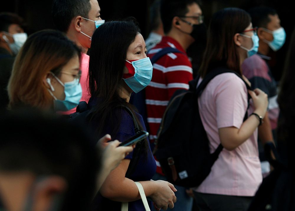 SIngapore will tighten controls over border entry as well as changing quarantine requirements. — Reuters pic