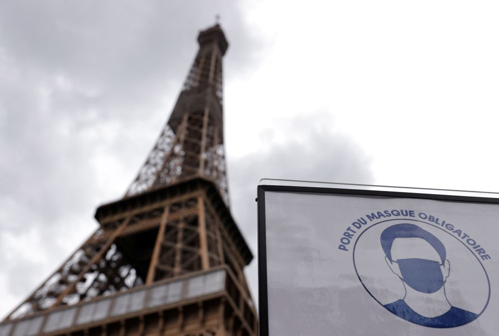 A sign that reads 'Mandatory to wear a mask on all the site' is seen at the entrance of the Eiffel Tower in Paris June 17, 2020. — Reuters pic