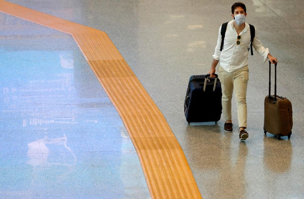 A passenger wearing a protective face mask walks at Fiumicino Airport, where new security measures have been implemented ahead of a further loosening of movement restrictions, in Rome, Italy, May 28, 2020. — Reuters pic