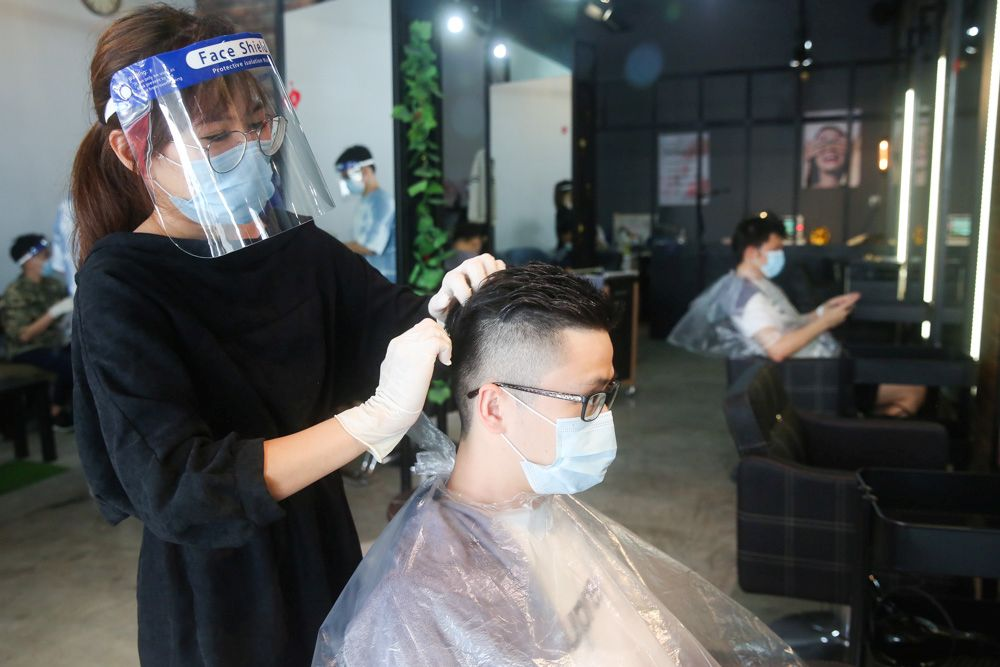 The defence minister said that salon and barber shop workers must also sanitise their equipments after servicing each customer. — Picture by Choo Choy May