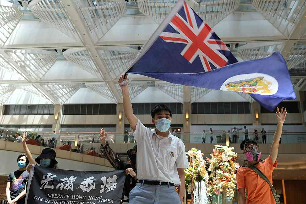 A pro-democracy demonstrator waves the British colonial Hong Kong flag during a protest against new national security legislation in Hong Kong, China June 1, 2020. — Reuters pic