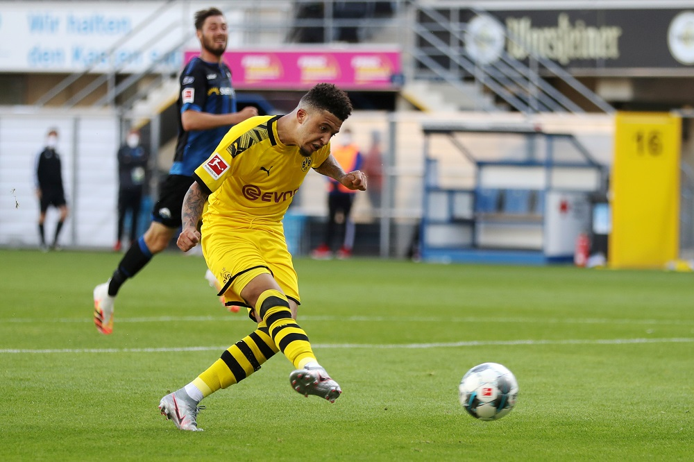 Borussia Dortmund's Jadon Sancho scores the sixth goal against SC Paderborn, as play resumes behind closed doors, June 1, 2020. ― Reuters pic