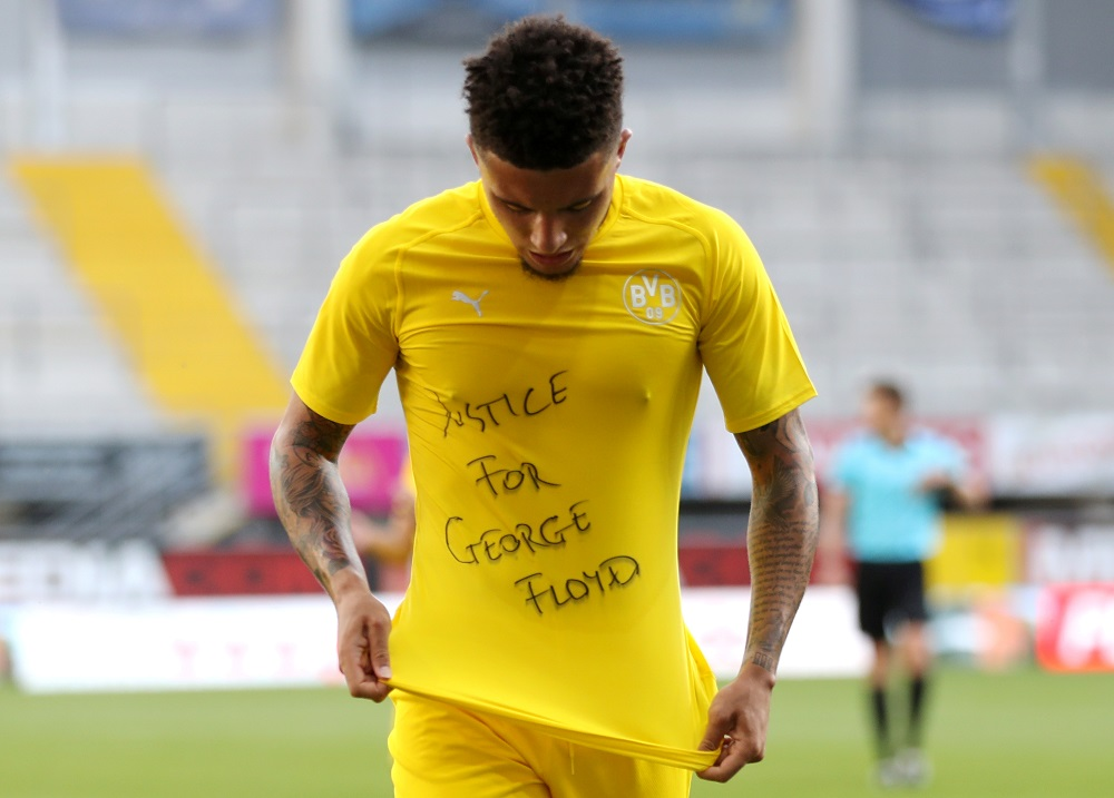 Borussia Dortmund's Jadon Sancho celebrates scoring the second goal with a 'Justice for George Floyd' shirt, June 1, 2020. ― Reuters pic