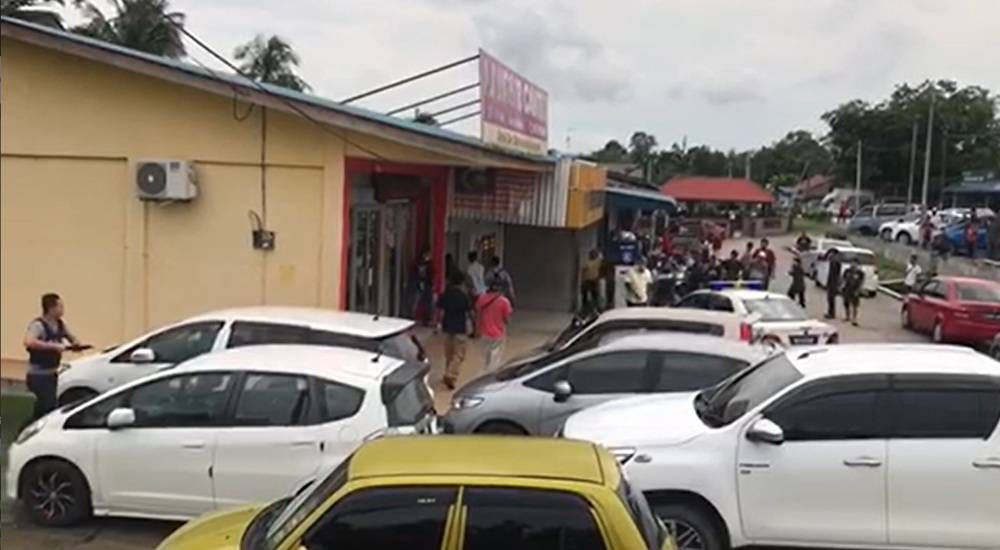 A screenshot of hostages running out of the bank in Kota Tinggi, Johor, June 18, 2020. — Picture from Twitter