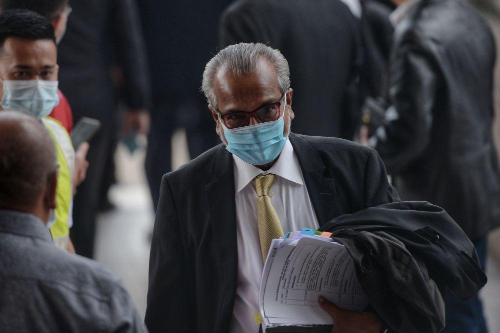 Lawyer Tan Sri Muhammad Shafee Abdullah arrives at the Kuala Lumpur High Court June 16, 2020. — Picture by Shafwan Zaidon