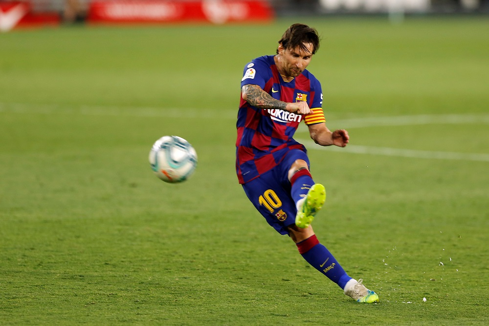 Barcelona's Lionel Messi takes a freekick during the match against Sevilla as play resumes behind closed doors June 20, 2020. Barca and Bayern are hoping to be among the eight teams who will head to the Portuguese capital for a 'Final Eight' mini tournament behind closed doors. ― Reuters pic