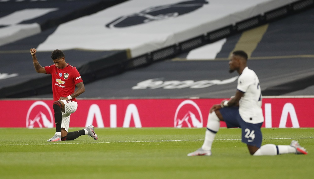 Manchester United's Marcus Rashford raises his fist as he kneels in support of the Black Lives Matter campaign before the match against Tottenham Hotspur June 20, 2020. ― Reuters pic