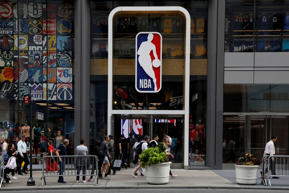 The NBA logo is displayed as people pass by the NBA Store in New York City October 7, 2019. — Reuters pic