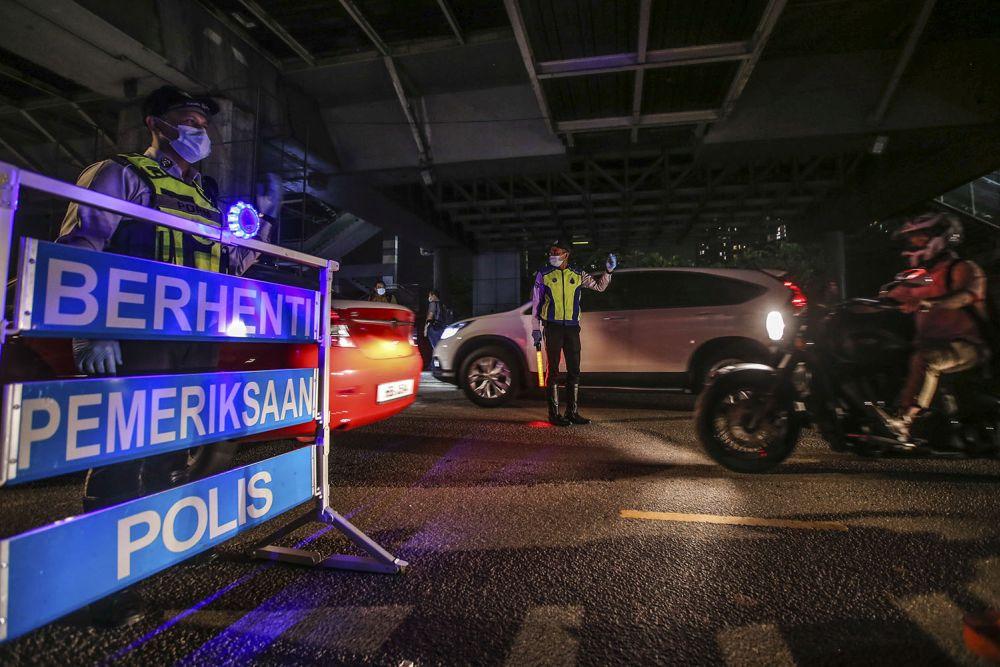 Police personnel man a roadblock on Jalan Hang Tuah in Kuala Lumpur June 3, 2020. — Picture by Hari Anggara