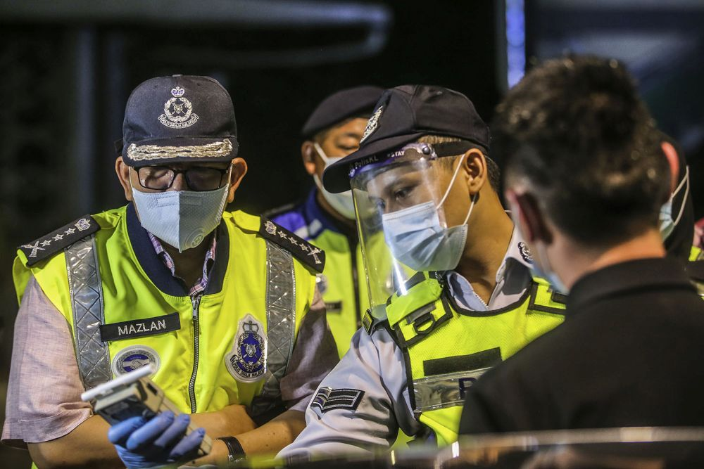 Kuala Lumpur police chief Datuk Seri Mazlan Lazim (left) is pictured at a police roadblock on Jalan Hang Tuah in Kuala Lumpur June 3, 2020. — Picture by Hari Anggara