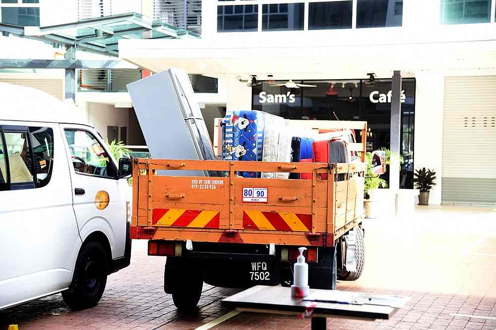 Pre-loved items waiting to be unloaded. — Picture courtesy of Facebook/ Kuan Chee Heng