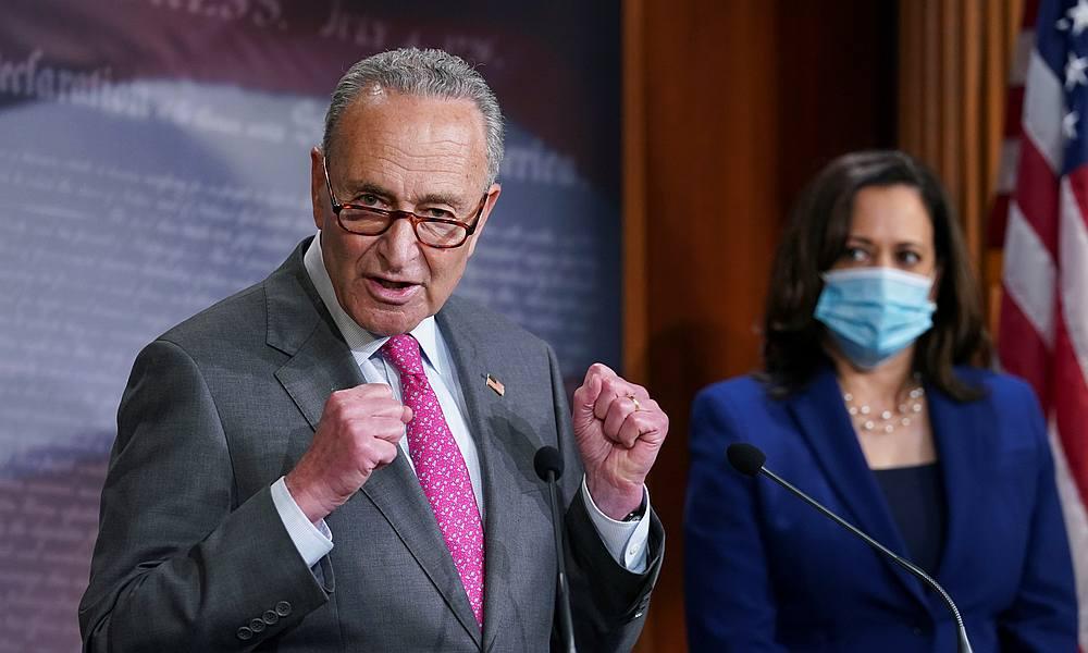 US Senator Kamala Harris listens as Senate Democratic leader Chuck Schumer speaks to reporters about police reform legislation at the US Capitol in Washington June 23, 2020. — Reuters pic