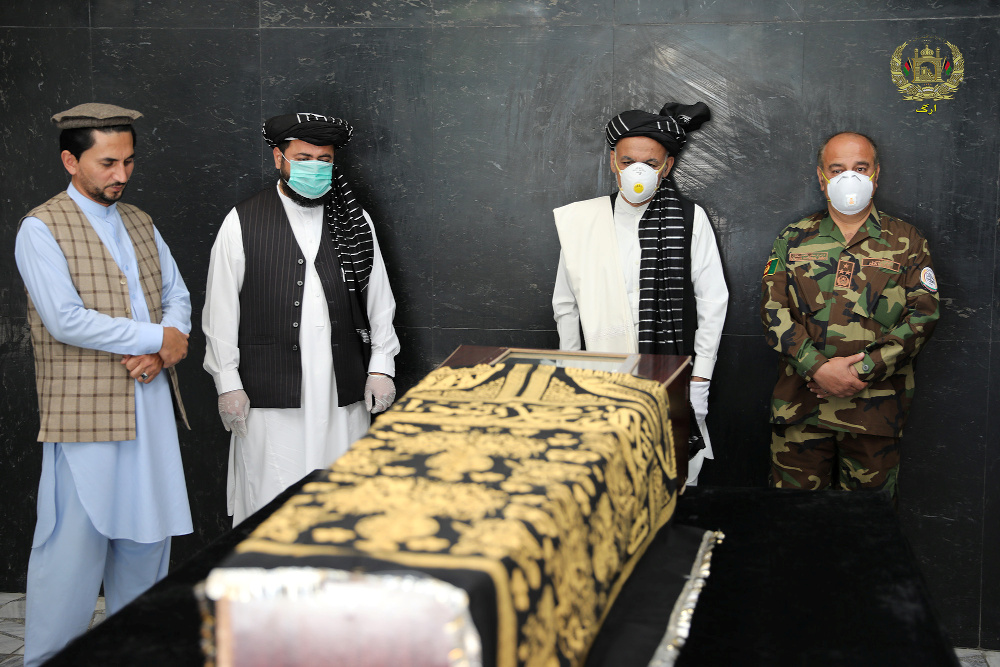 Afghanistan's President Ashraf Ghani (2nd right) stands over the coffin of Ayaz Niazi, a well-known scholar, who was killed last night by a bomb blast in Kabul June 3, 2020. — Picture by Afghan Presidential Palace/Handout via Reuters