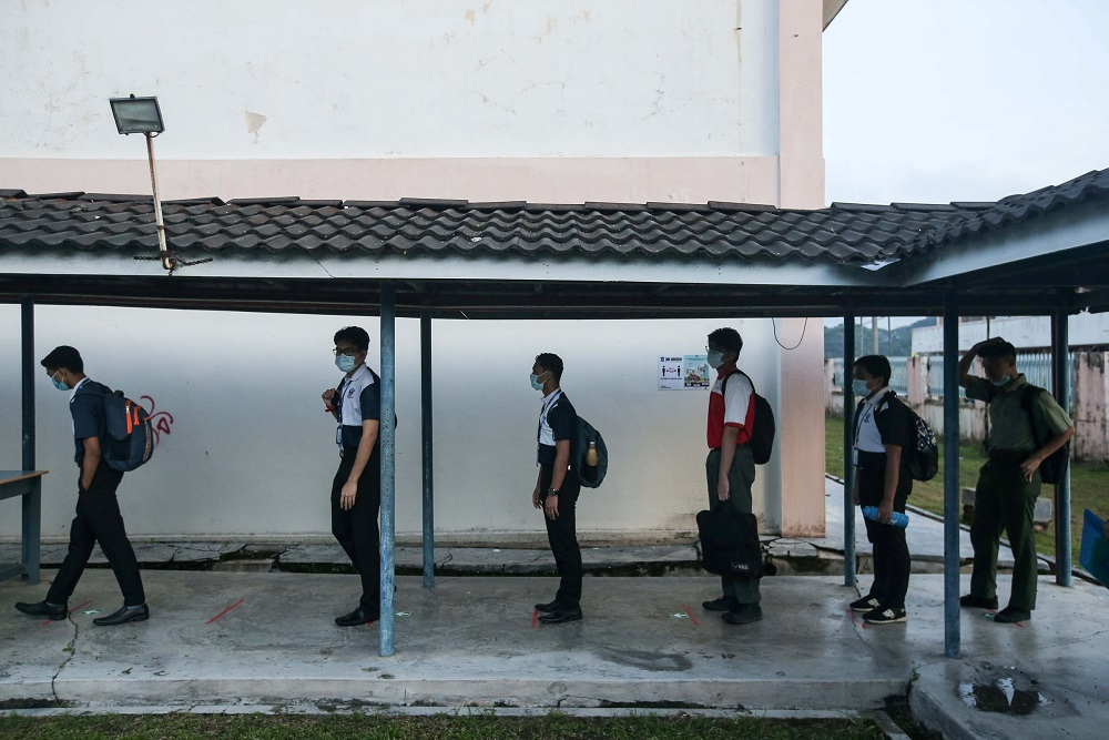 Students practice social distancing at SMK Anderson in Ipoh June 24, 2020. ― Picture by Farhan Najib