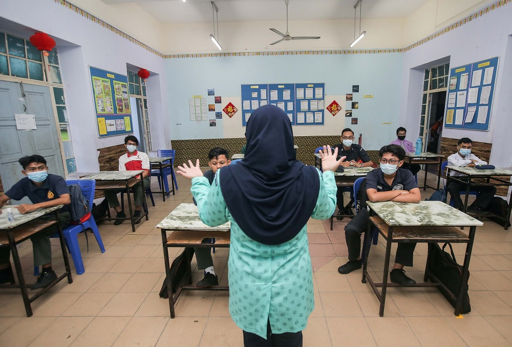 Social distancing is observed in the classroom at SMK Anderson in Ipoh June 24, 2020. ― Picture by Farhan Najib